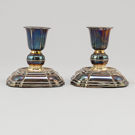 A pair of silver candlesticks from k&ec, gothenburg, 1958