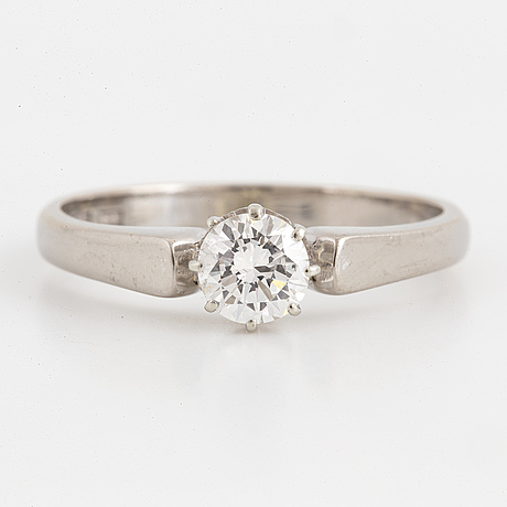 An 18k white gold ring set with a round brilliant cut diamond