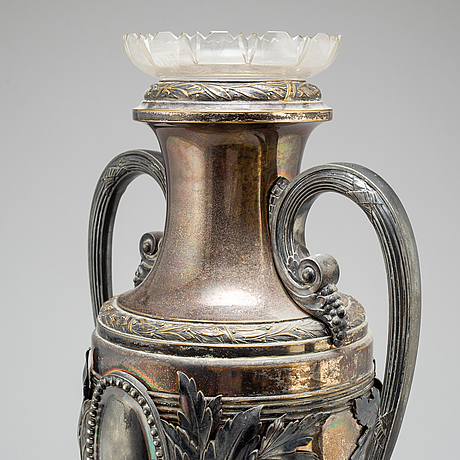 An early 20th century silverplate and glass vase