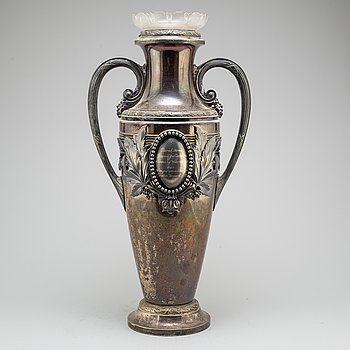 An early 20th century silverplate and glass vase.