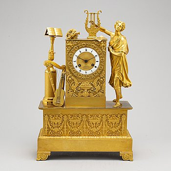 A French Empire mantel clock, first quarter 19th century.