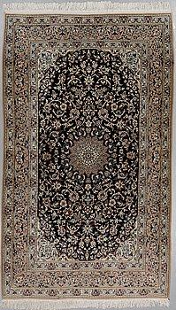 A RUG, Nain, part silk, ca 270 160 cm.