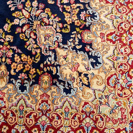 A carpet, old kerman, ca 336 x 239 cm.