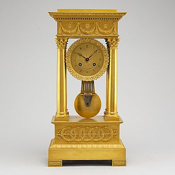 A French Empire mantel clock, first quarter of the 19th century.