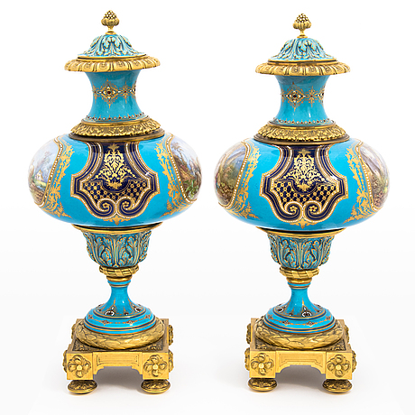 A pair of late 19th-century porcelain urns, sèvres-like mark.