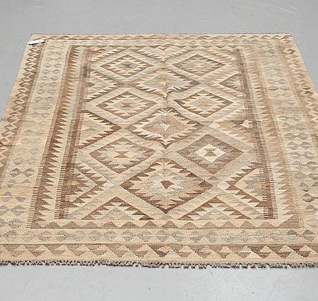 A rug, kilim, ca 245 x 167 cm.