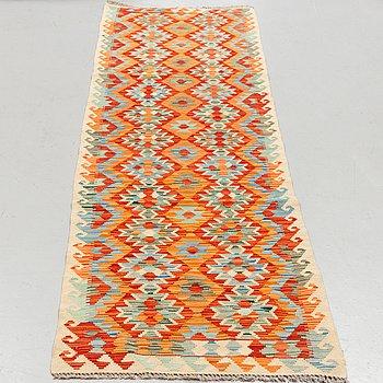 a carpet, Kilim, ca 304 x 80 cm.