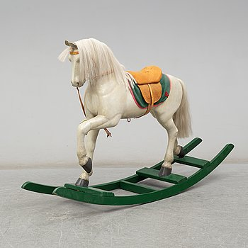 A rocking horse, early 20th Century.