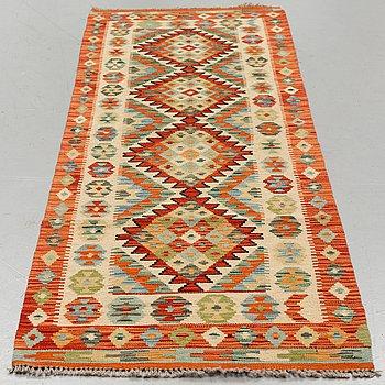 A carpet, kilim, around 245 x 76 cm.