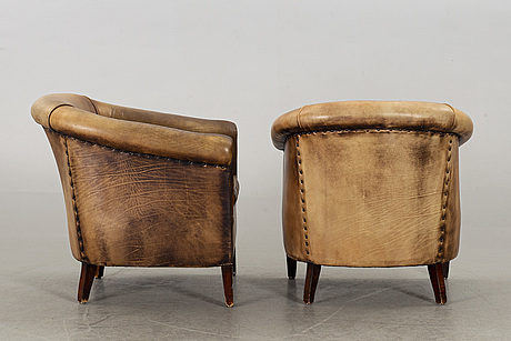 A pair of leather armchairs