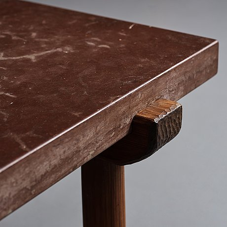 Axel einar hjorth, a red limestone top and stained pine side table, nordiska kompaniet, sweden 1929.
