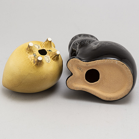 Lisa larson, two stoneware figurines and a pair of candle holders, from gustavsberg