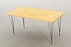 A birch veneered dining table by bruno mathsson and piet hein