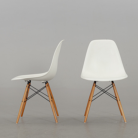 "A pair of ""plastic chair"" by charles & ray eames, vitra 2009"