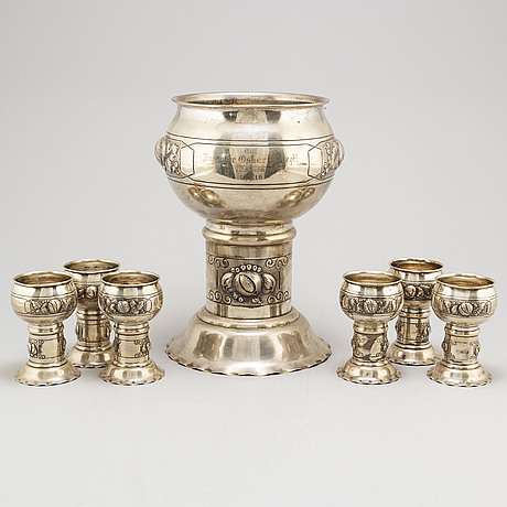 A swedish art noveau grand parcel gilt seven piece punch set. maker's mark cg hallberg, stockholm, 1916