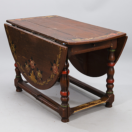 A painted 18th century baroque gate leg table