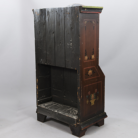 A painted 19th century folk art bed cabinet