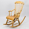 A wooden rocking chair