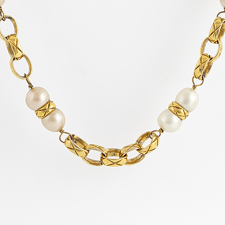 A necklace, by chanel according to information given.