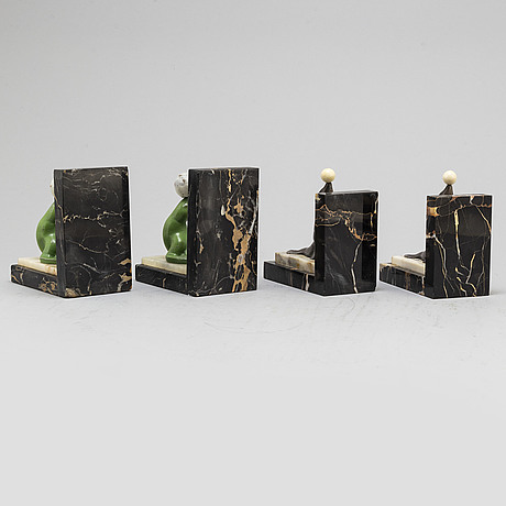 Two pairs of 20th century art deco bookstands decorated with sealions