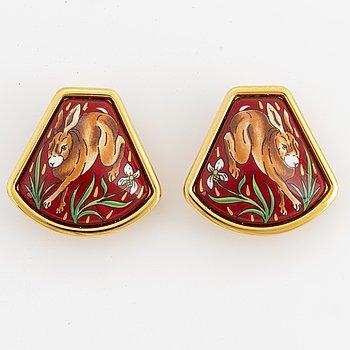 A pair of Hermès earrings.