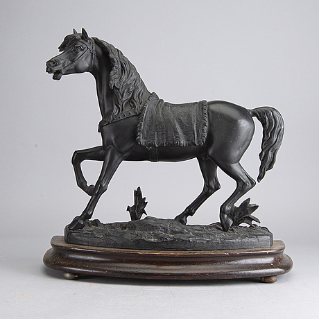 An early 20th century horse sculpture
