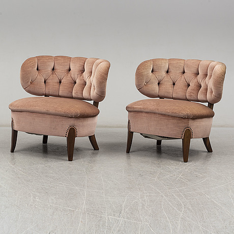 A pair of 'schulz' easy chairs by otto schulz, second half of the 20th century