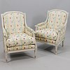 A pair of gustavian style lounge chairs, 20th century