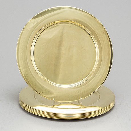 Eight brass plates by stelton, denmark, second half of the 20th century