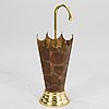 A 20th century umbrella stand in copper and brass