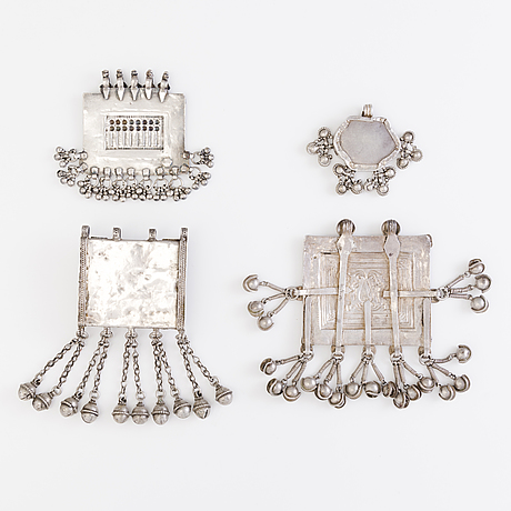 Four pendants, silver, north india before 1960's.