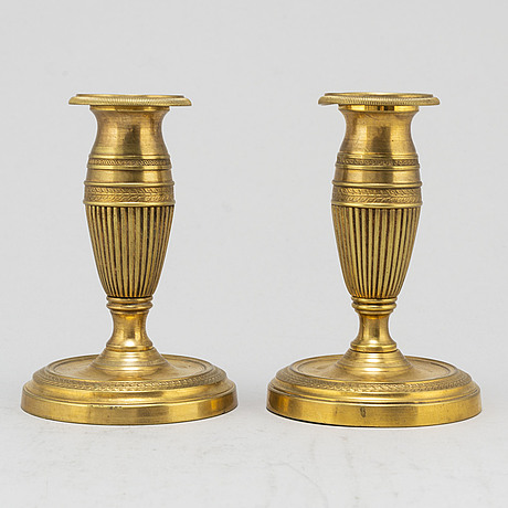 A pair of brass 19th century candlesticks