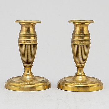 A pair of brass 19th century candlesticks.
