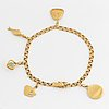 An 18k gold bracelet set with charms