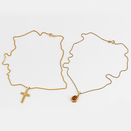 Two pendant in 18k gold with one chain 18k gold and one silver chain