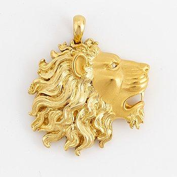 A Carrera y Carrera pendant in 18K gold set with a diamond.