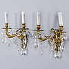 A pair of bohemian bronze wall chandeliers, around mid 20th century