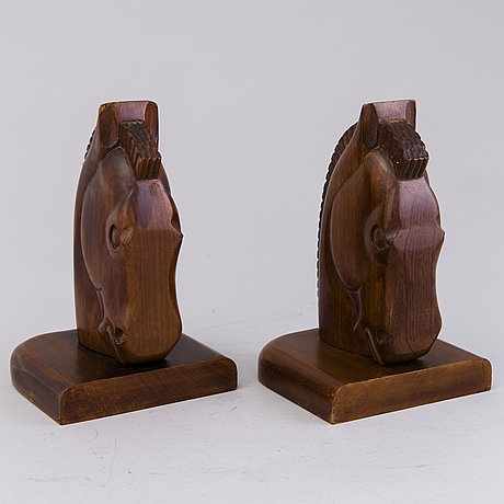 A pair of wooden art deco bookends