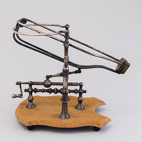 Mechanical wine decanting cradle, around 1900