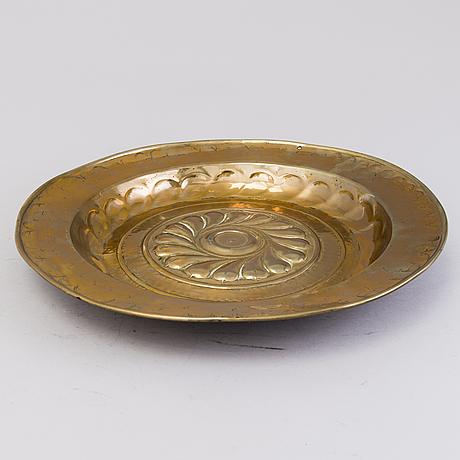A 16th century brass baptism dish from nürnberg, germany