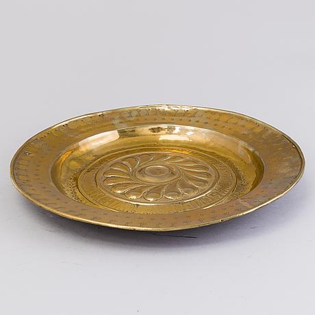 A 16th century german brass baptism dish from nürnberg
