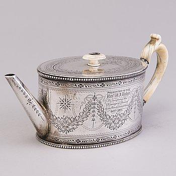 A Victorian silver teapot by Charles Boyton & Son, London 1876.