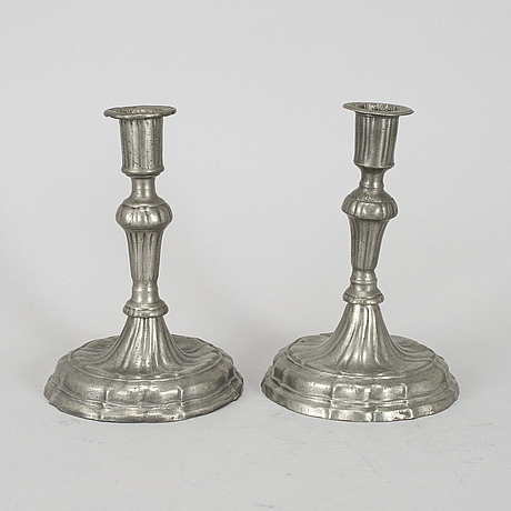A pair of rococo pewter candlesticks, 18th century.