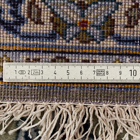 A carpet, kashan, signerad ezani ca 394 x 302 cm