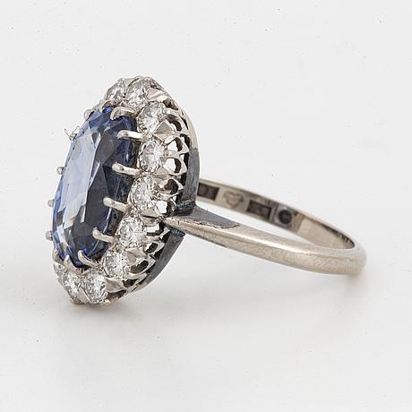 Sapphire and brilliant-cut diamond cluster ring.