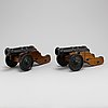 A pair of cast iron model canons from stafsjö bruk, 20th century