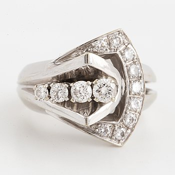 An 18K white gold ring set round brilliant-cut diamonds.