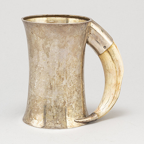 A silver jug made by axel bergman, stockholm in 1904