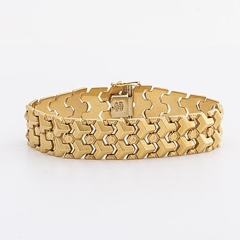 An 18K gold bracelet, weight 25,5 gr, length 19 cm, bredd 16 mm.