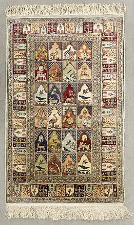 An old silk signed hereke carpet ca 135 x 88 cm